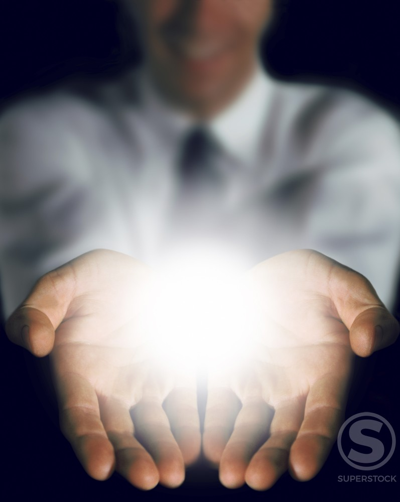 Person's hands with light emanating : Stock Photo