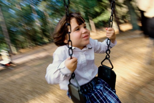 Stock Photo: 1201-106 Close-up of a girl swinging on a swing