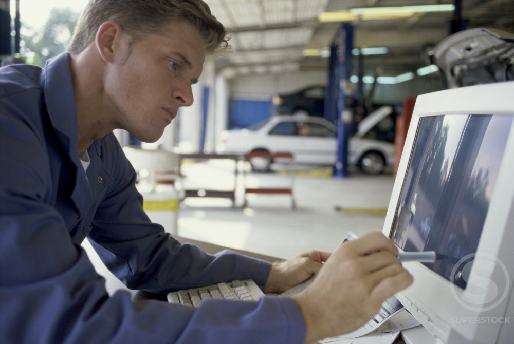 Stock Photo: 1202-149 Side profile of a young man using a computer