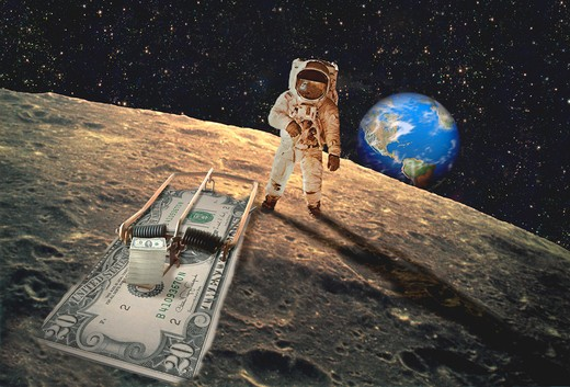 Stock Photo: 1204-182 Astronaut with a money trap on the moon