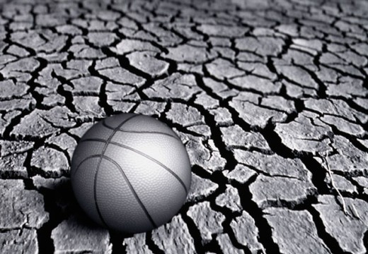Close-up of a basketball on a cracked surface : Stock Photo