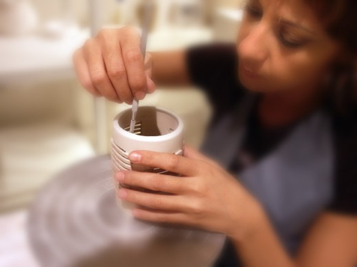 Stock Photo: 1220-607 High angle view of a young woman designing pottery