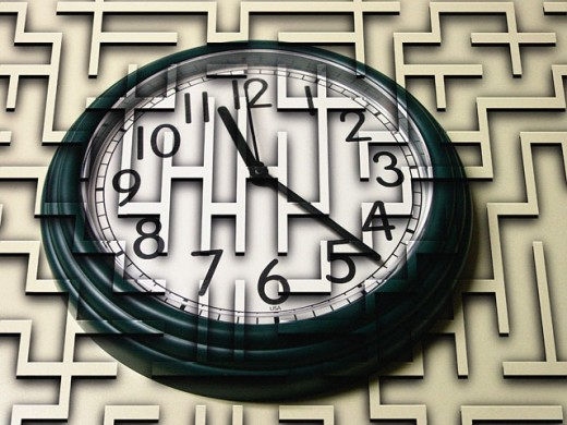 Stock Photo: 1220-946 Close-up of a clock superimposed on a maze