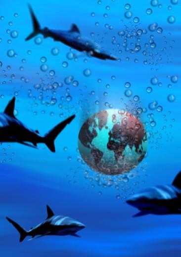 Sharks swimming in water around a globe : Stock Photo