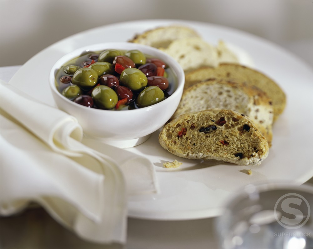 Stock Photo: 1236-151 Close-up of olives and breads on a plate