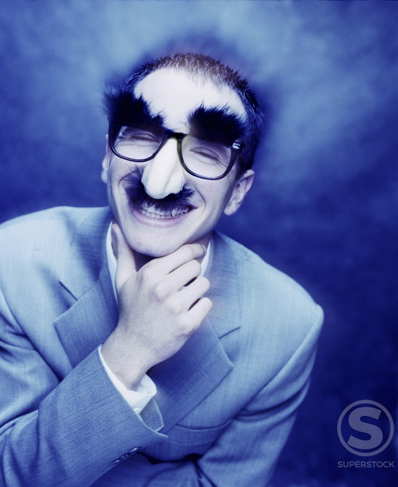 Man wearing a Groucho Marx disguise : Stock Photo