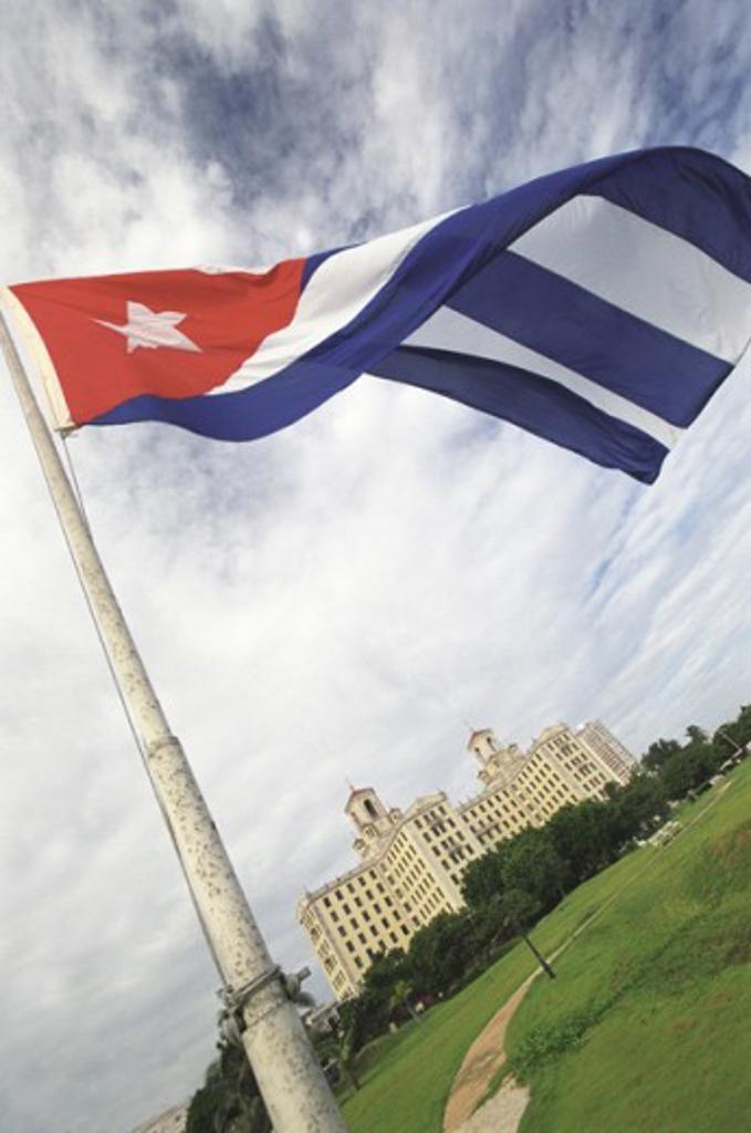 Flag of Cuba fluttering at Hotel Nacional, Havana, Cuba : Stock Photo