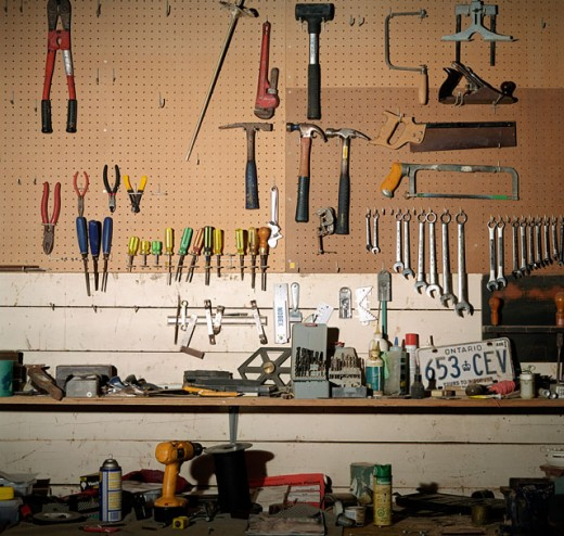 Stock Photo: 1241-1609 Tools hanging from a pegboard in a workshop