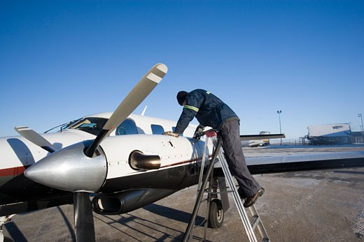 Man refueling an airplane : Stock Photo