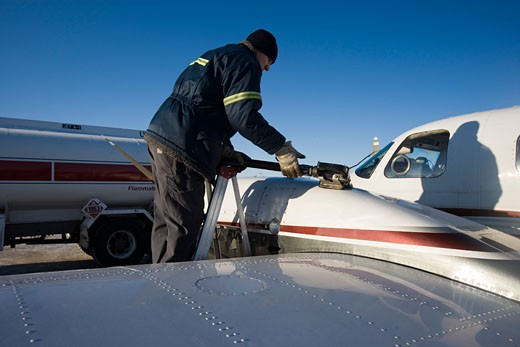 Stock Photo: 1241-1789A Man refueling an airplane