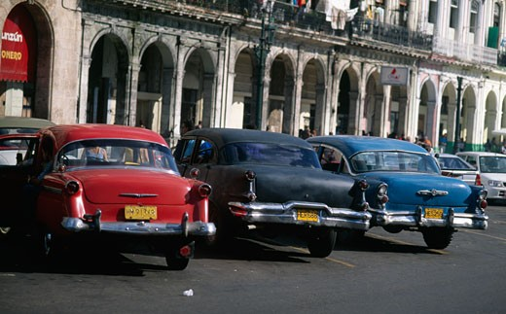Stock Photo: 1241-580 Rear view of vintage cars parked on street,  Havana,  Cuba