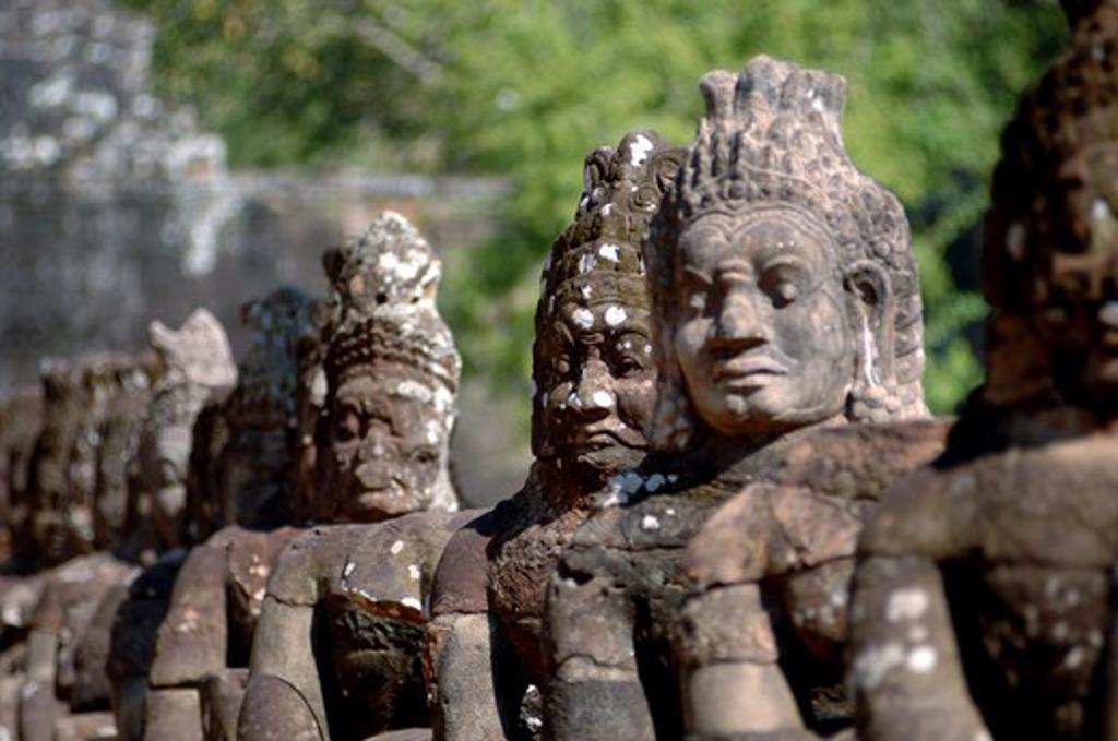 Stock Photo: 1245-663 Cambodia, Siem Reap, Angkor Wat, close up of ancient statues