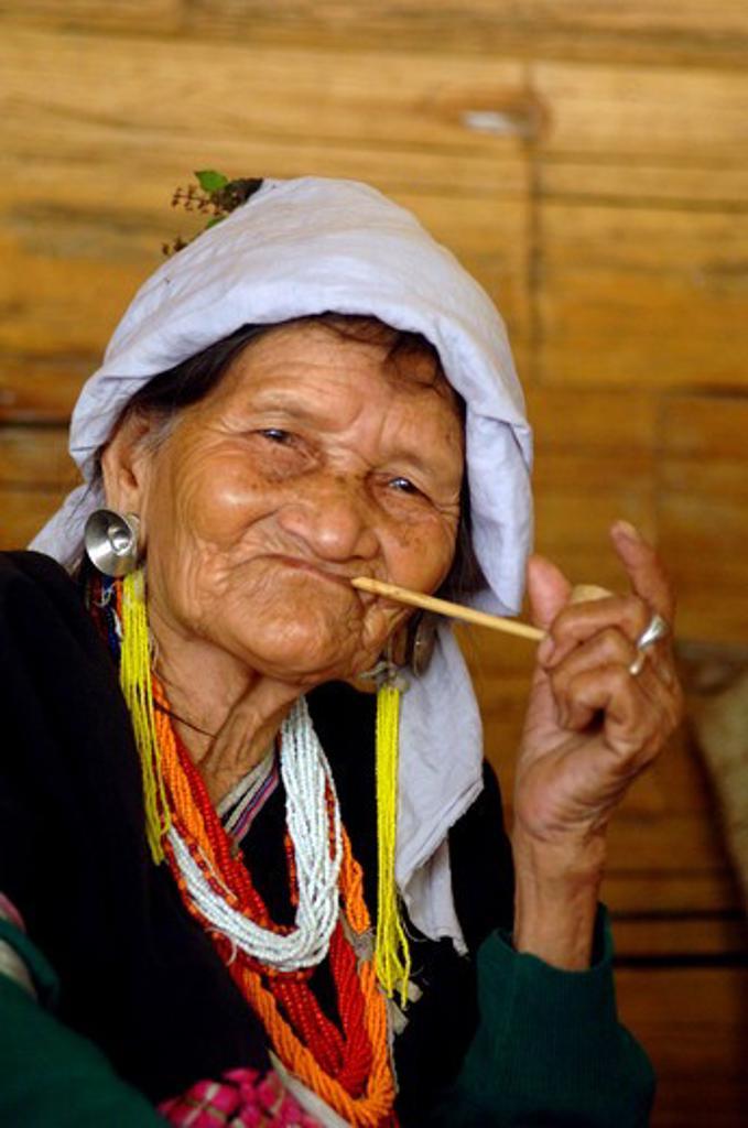 Stock Photo: 1245-671 Thailand, Chang Mai, Elderly indigenous woman from Lahu Shi Baiah tribe smoking pipe