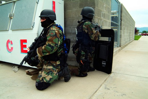 Stock Photo: 1245-W645 Side profile of two SWAT team members taking position