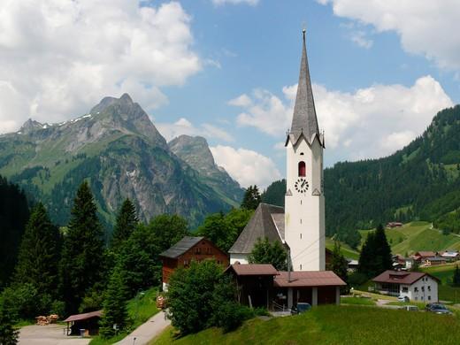 Stock Photo: 1246-1066 Austria, Vorarlberg, Schrocken, Heimboden, Parish church in mountain landscape