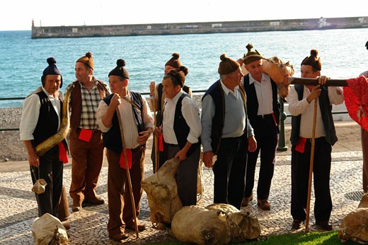 Stock Photo: 1246-984 Members from a Porto da Cruz folklore group with wineskins wearing traditional caps, Funchal, Madeira, Portugal