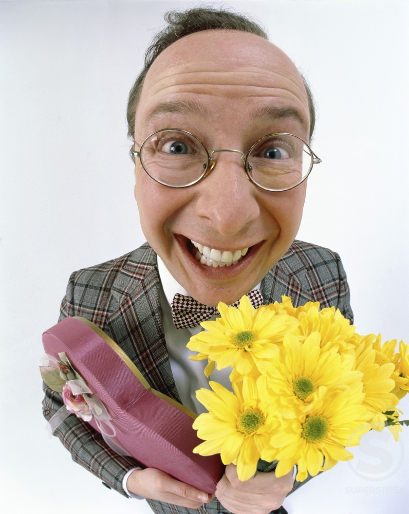 Stock Photo: 1260-122 Close-up of a man holding a box of chocolates and a bouquet of flowers