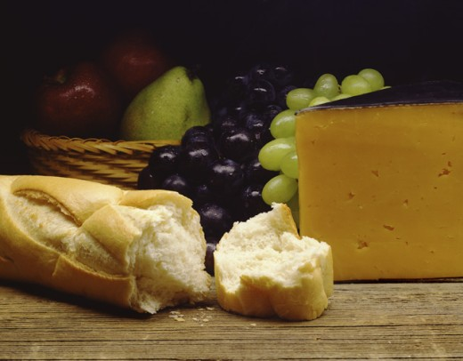 Close-up of a bread with cheese and fruit : Stock Photo