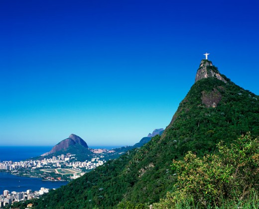Stock Photo: 1269-1199 Low angle view of a statue on a top of a mountain, Christ the Redeemer Statue, Mount Corcovado, Rio de Janeiro, Brazil