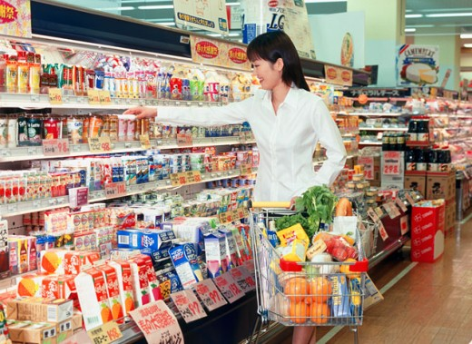 Stock Photo: 1269-1388 Young woman shopping in a supermarket