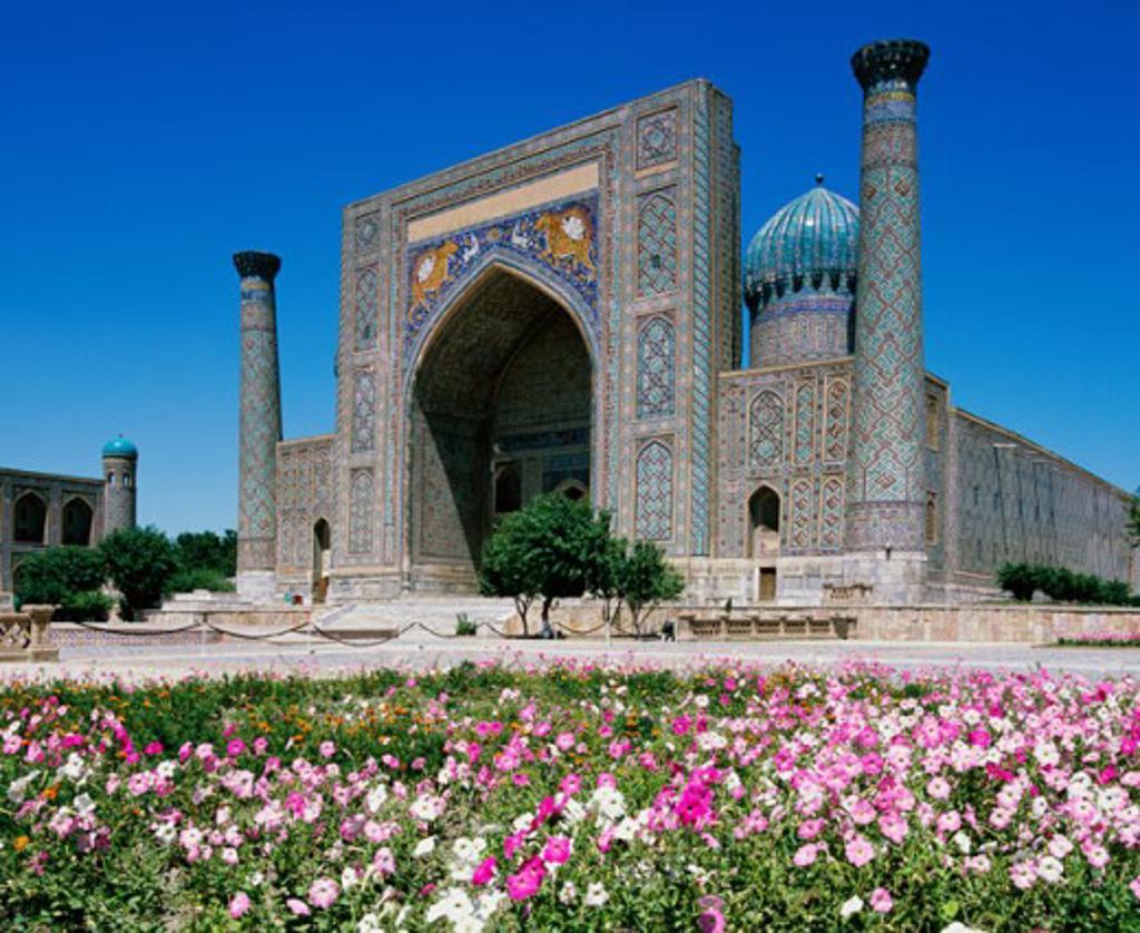 Flower bed in front of a madressa, Shir Dar Madrasa, Samarkand, Uzbekistan : Stock Photo