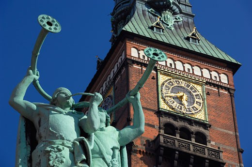 Stock Photo: 1269-2302 Low angle view of statues in front of a clock tower, City Hall, Copenhagen, Denmark