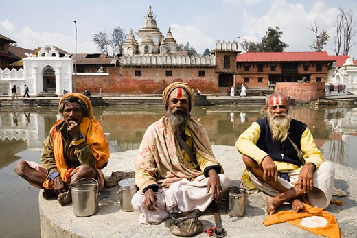 Stock Photo: 1269-2431 Three sadhus sitting together at a religious festival, Maha Shivaratri, Kathmandu, Nepal
