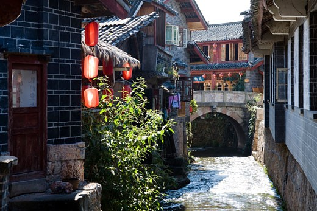 Buildings along a street, Lijiang, Yunnan Province, China : Stock Photo