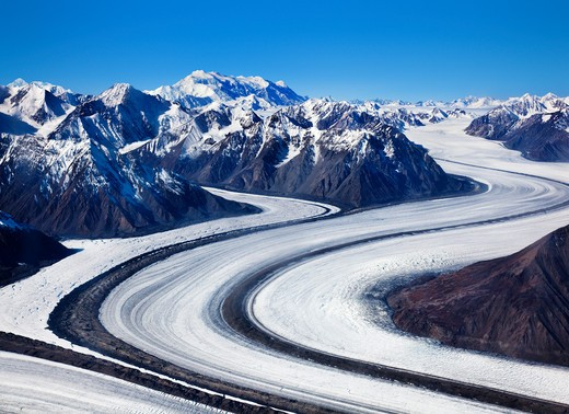 Stock Photo: 1269-3232 Snow covered road passing through mountains, Kaskawulsh Glacier, Kluane National Park, Yukon, Canada