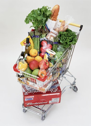 High angle view of a shopping cart with groceries : Stock Photo