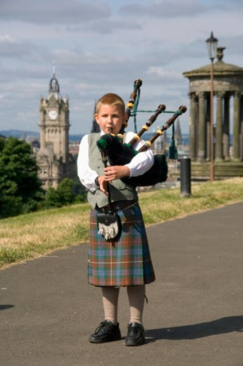 Stock Photo: 1269-W2232 Portrait of a bagpiper playing a bagpipe, Edinburgh, Scotland