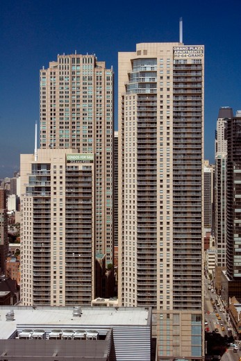 Skyscrapers in a city, Grand Plaza I, State Street, Chicago, Illinois, USA : Stock Photo
