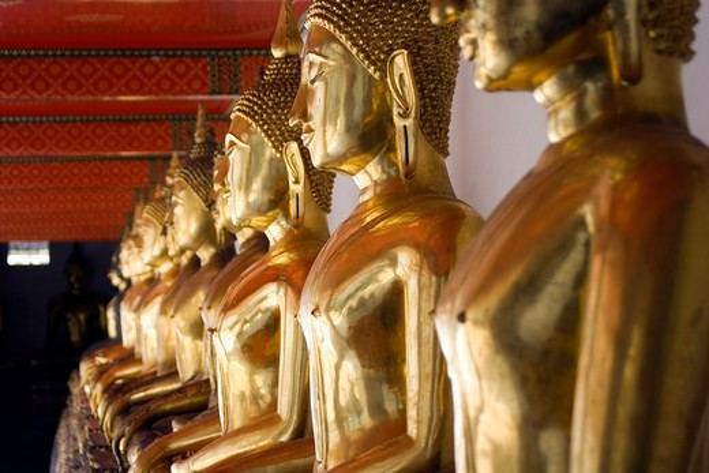 Thailand, Bangkok, Wat Pho, Line of golden female Buddha statues : Stock Photo
