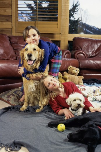 Stock Photo: 1284R-1062 Portrait of two girls with two dogs