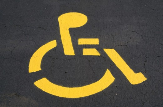 Handicapped sign painted on a road : Stock Photo