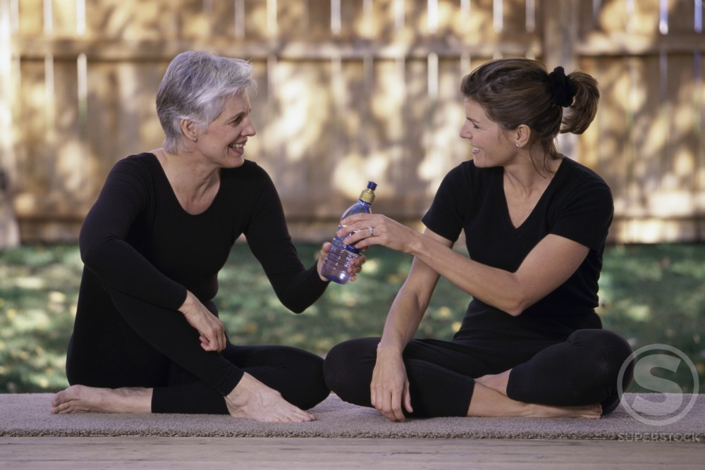 Stock Photo: 1284R-310 Mother and her daughter sitting together