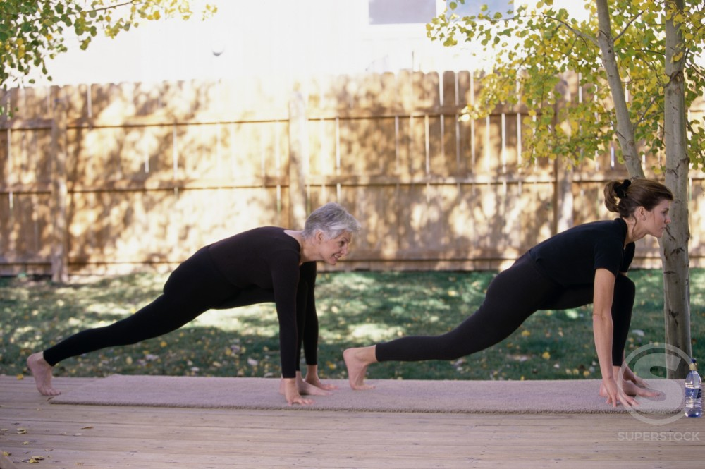 Stock Photo: 1284R-311 Mother and daughter exercising