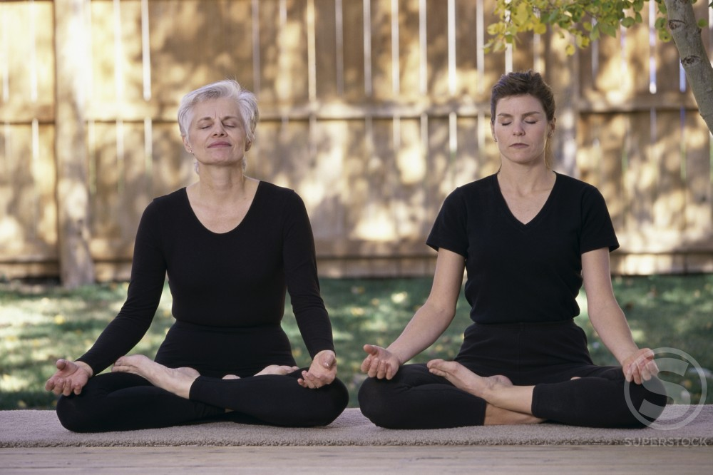 Stock Photo: 1284R-313 Mother and daughter exercising