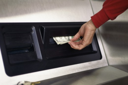 Stock Photo: 1284R-984 Person taking cash from an ATM