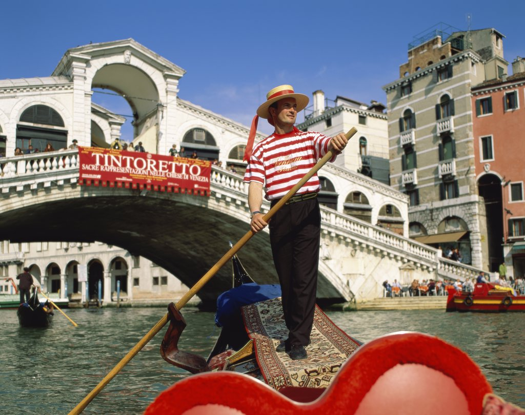 Stock Photo: 1288-1322 Low angle view of a gondolier, Grand Canal, Venice, Italy