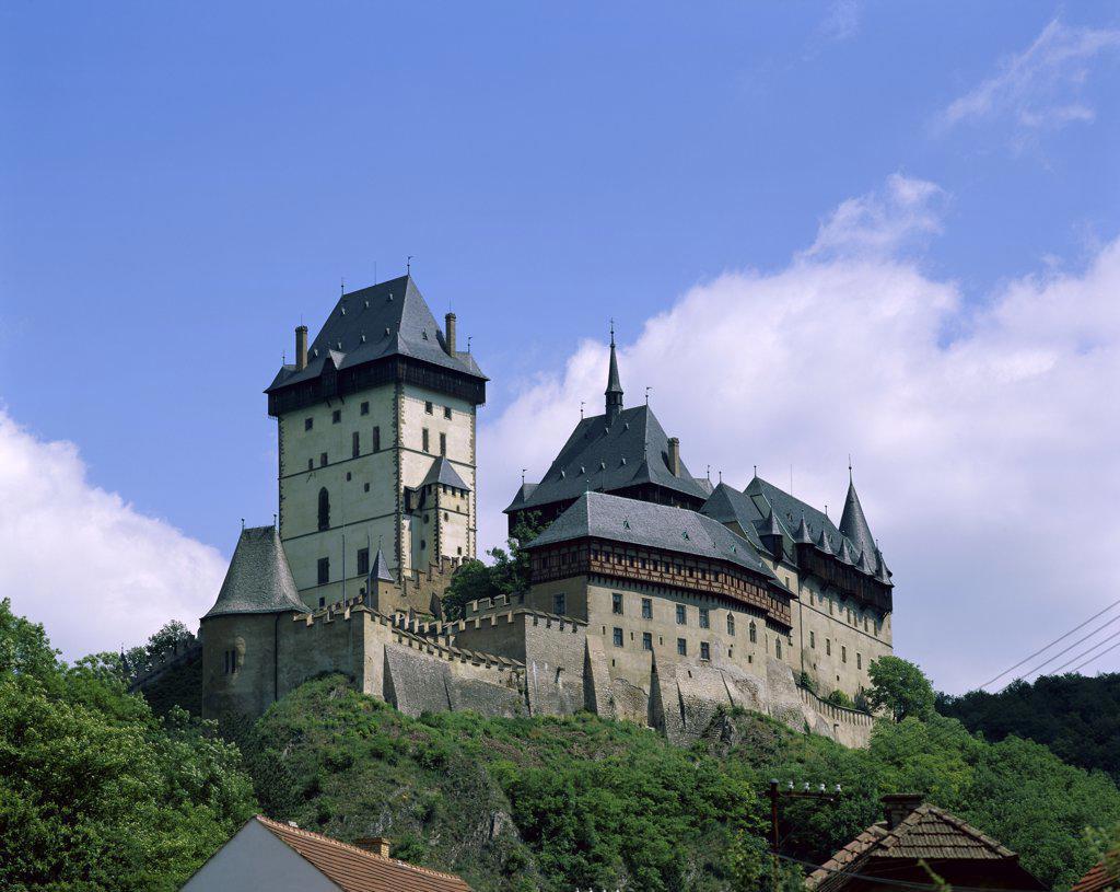 Stock Photo: 1288-1460 View of a castle on a hill, Karlstejn Castle, Berounka Valley, Czech Republic