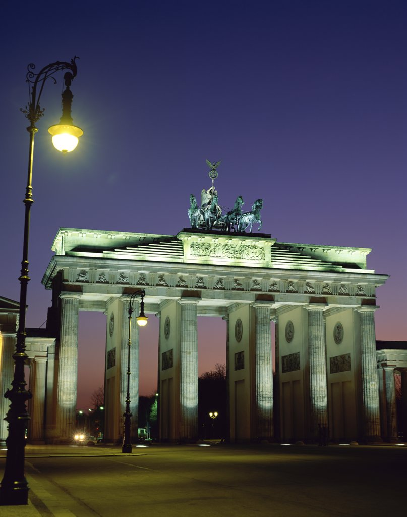 Stock Photo: 1288-1492 Low angle view of a gate lit up at dusk, Brandenburg Gate, Berlin, Germany