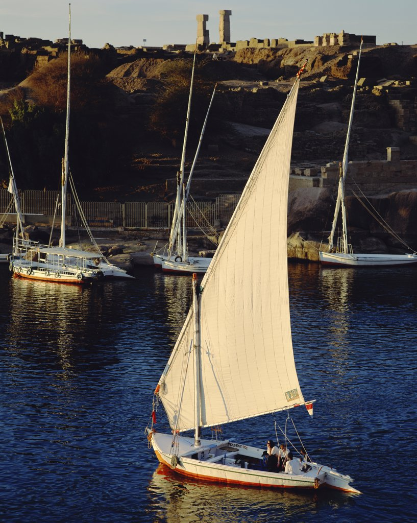 High angle view of a group of people sitting in a sailboat, Nile River, Aswan, Egypt : Stock Photo