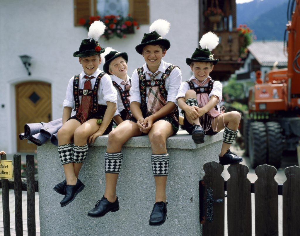 Stock Photo: 1288-1522 Portrait of boys sitting in a Bavarian festival, Bavaria, Germany