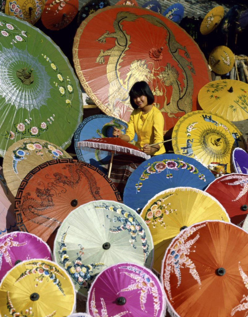 Portrait of a young woman painting a parasol, Chiang Mai Province, Thailand : Stock Photo