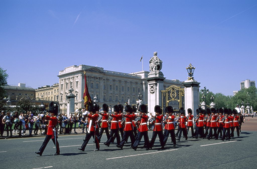 Stock Photo: 1288-1792 British Royal Guards marching in front of a palace, Changing of the Guard, Buckingham Palace, London, England