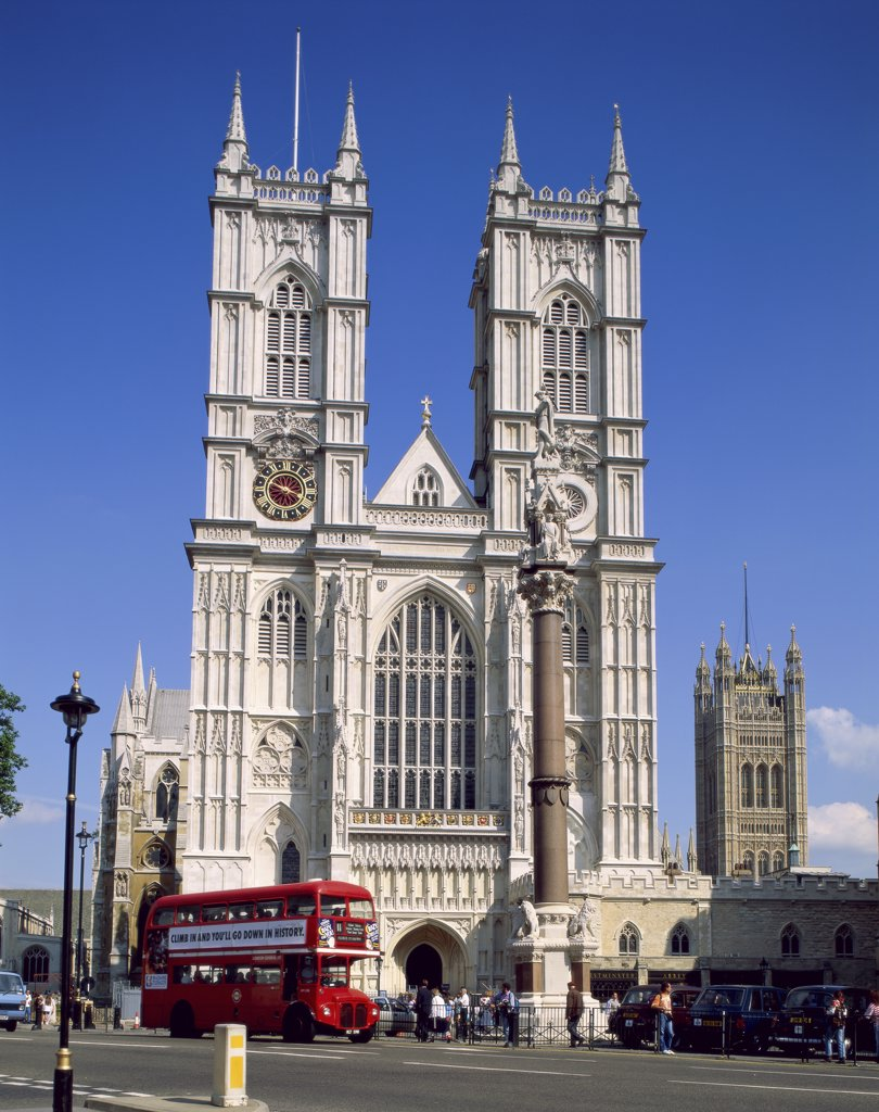 Double-decker bus in front of a church, Westminster Abbey, London, England : Stock Photo