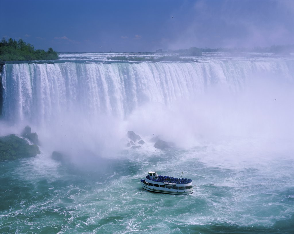 Stock Photo: 1288-1892 High angle view of a tourboat in front of a waterfall, Niagara Falls, Ontario, Canada