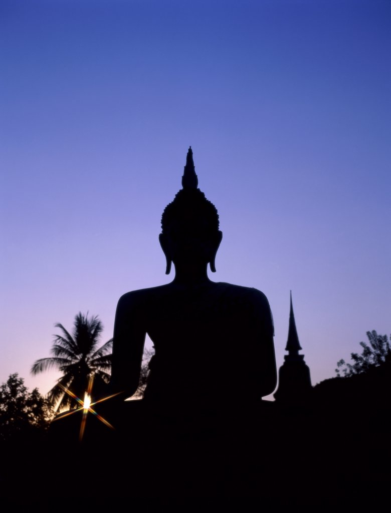 Silhouette of the statue of Buddha and temple during sunset, Sukhothai, Thailand : Stock Photo
