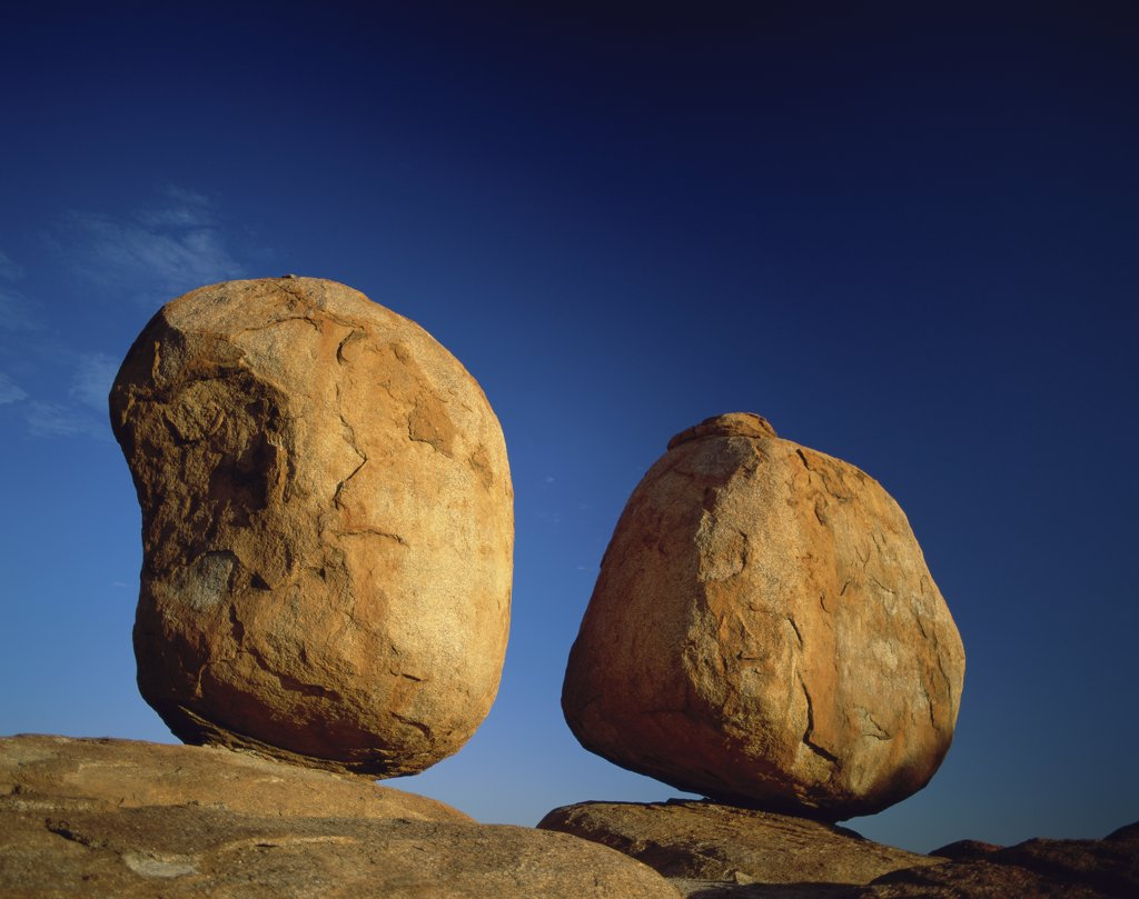 Stock Photo: 1288-375 Low angle view of two rocks, Devil's Marbles, Northern Territory, Australia